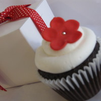 Red Flower Cupcake. Chocolate cake with snow white buttercream icing. Fondant flower with edible silver bead.