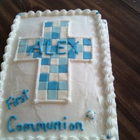 First Communion Cake This is a white cake covered with buttercream. The cross is made from mm fondant pieced together like a mosaic. It was fun to make.