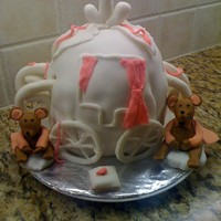 Cinderella Carriage Cake  My first attempt at this. Had trouble covering the cake smoothly with fondant. As well the cake was soft , could not hold the mice....it...