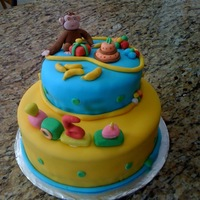 Curious George Chocolate cake with chocolate ganache. Chocolate filling. Everything made from fondant...even George!!