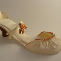 Shoe Art Hand sculpted from fondant w/ copper pearl dust.