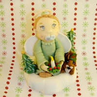 Winter Baby  Everything is made out of fondant. I know it isn't the holidays yet but I figured this little guy will help get me in the holiday...