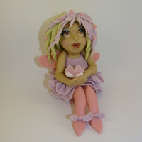 Flower Fairy   Hand sculpted using fondant.