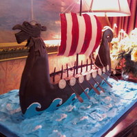 Viking Ship A viking ship groom's cake I created! Modeling chocolate details, cake ship, gumpaste sail, and frosting water.