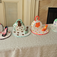 Purse And Shoes Vanilla cakes, with vanilla buttercream and fondant covering. Shoes are fondant and modeling chocolate.