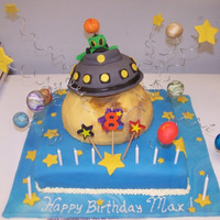 Out Of This World 12 inch square cake with vanilla cake, vanilla frosting, fondant covering, planets made out of fondant, moon out of rice crispy treats,...