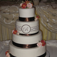 Wedding4-10 Fudge and marble layer cake with fudge and vanilla buttercream frosting. White chocolate fondant, sugar roses, satin ribbon and edible...