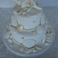 Shell Wedding   All white Sea shell wedding cake. Shells are fondant, sand dollars are chocolate.