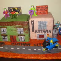 Gotham City Cake  My grandson was having a Batman themed party for his fifth birthday and wanted a Gotham City cake. Needless to say, he was thrilled with...
