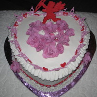 Valentine's Day - Just For Fun Red velvet cake covered in butter cream with fondant accents - roses, cutouts and gumpaste cupid