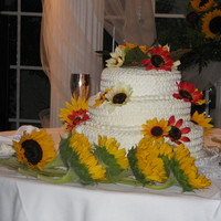 Omar And Karin Rum cake with royal icing and silk flowers