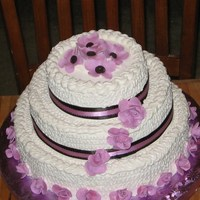 Aubrey And Jen's Wedding Rum cake with royal icing and fondant flowers. Wedding colors orchid pink and chocolate