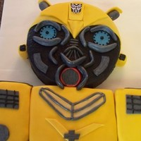 Transformers Bumble Bee Made for a 4 year olds birthday who loves bumble bee.Covered in buttercream and fondant.Chocolate cake filled with bavarian cream.TFL