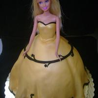 Gold Barbie all white cake with buttercream filling. Airbrushed gold with black fondant accents