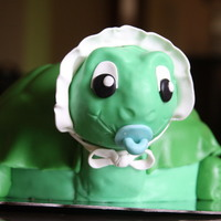 Turtle Baby Shower Cake White cake with strawberry mousse filling covered in MMF. Head is RKT.
