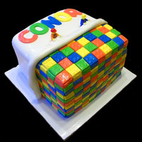 Lego Cake  I had issues with HOW people put Legos on their cake. Legos don't bend to go around a round cake and they dont have pegs on multiple...