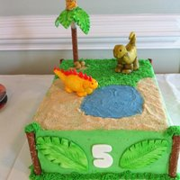 "Dinosaur / Jungle Theme With A Monkey  The child requested ""a cake with a dinosaur, and a jungle with a tree and a monkey with the tree"". Cake is decorated with..."