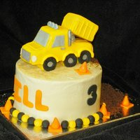 "Construction Dump Truck Cake Asked to do a construction cake. Those are 3 layers of 8"" rounds, filled. White is butter cream. Dirt is Oreo crumbs & brown sugar..."