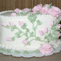 Rose Garden Pound Cake w/ guava filling. Buttercream icing and flowers. I know I can see some crums. I only had a few hours to do this cake and that...