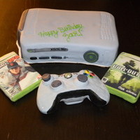 Xbox 360 Vanilla cake with blue strawberry filling. Games and controller made of rice krispies, chocolate and fondant.