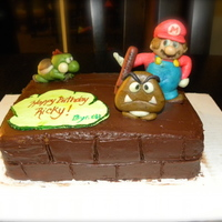 Super Mario This was a butter cake with chocolate filling and icing. The characters on top are made out of marzipan.