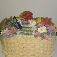 Spring Basket Vanilla Cake with cinnamon buttercream. Royal icing flowers and gumpaste roses.