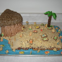 Teddy Bear Beach Day  Birthday cake for my nephew's 1st birthday. The beach is coconut cake with macaroon topping and then cake crumbs and brown sugar for...