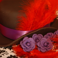 Burlesque Hat....   I made this for my husband....burlesque style...The hat was a chocolate brownie, flowers fondant.