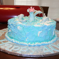 Dolphins I made this for a 40th Birthday party. It is a chocolate WASC cake with buttercream. Dolphins, fairy, water spout made of fondant. The...