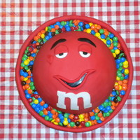 Red M&m Birthday Cake I made this for a friend's father for his birthday. He is an M&M fanatic. The cake matches a personalized candy dish. I did WASC...