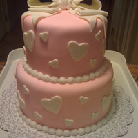 Wedding Shower Love Cake This cake was made with MMF to cover the cake, MMF hearts, and a MMF/gum paste bow. The bride loved the surprise!