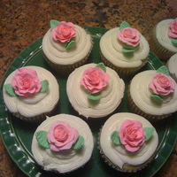 Cupcakes W Roses! These were a gift for mom for mothers day! The roses were made from fondant and gumpaste.