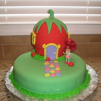"Strawberry Shortcake's House! Cake made for my niece's birthday. Bottom is 1 10"" round, torted. Strawberry is 2 6"" rounds, with 1/2 ball pan on top...."