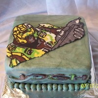 Halo Video Game Cake   Birthday Cake for fan of Halo video game. All edible - made from candy melts. Even used the font from the video game to write the name.