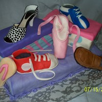 "Shoe Cake Made for a fundraiser whose theme was ""Walk A Mile in their shoes"". All decorations are completely edible!"