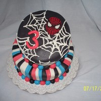 Spidey Cake Spidey on a whimsical cake. All edible decorations.