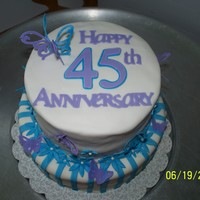 45Th Sapphire Anniversary Butterfly Customer wanted an anniversary cake for her parents, and just wanted it to be pretty. She said mom liked butterflies and the color purple...