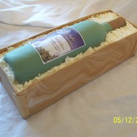 "Wine Bottle Cake By Sweet Indulgences - Il Bottle is made from fondant/gumpaste. Crate is fondant, and ""packing material"" is candy melts."