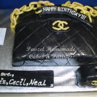Edible Chanel Bag And Mini Purse Cake Rich chocolate cake covered with fondant icing and decorated to resemble a Chanel Bag. The candle holder is made of rich chocolate cake...
