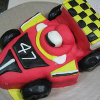 The Race My own attempt of a cake decoration from Debbie Brown. The cake is Devil's Food Cake and the icing is MMF.