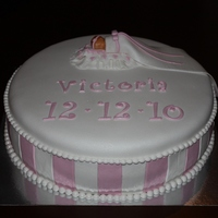 Victorias First Communion chocolate cake with vanilla cream and melted chocolate, cover and decorations are in marzipan