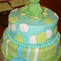 Frog Baby Shower Cake  Two tier baby shower cake made for my friends. Chocolate tier and vanilla tier covered and filled with buttercream. Fondant decor. Frog is...
