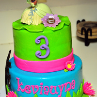 "Princess And The Frog 3rd Birthday Cake. 8"" double layer and 6"" double layer vanilla with buttercream and MMF."