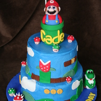 "Mario Cake 8"" and 6"" cakes with RKT tube. Iced in buttercream dream with all fondant decorations."