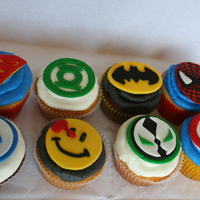 Superhero Cupcakes Made these for my brother's comic shop grand opening. They were choc/vanilla with vanilla buttercream dream and a fondant decoration...
