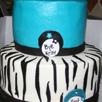 Zebra And Teal Goodbye Cake 9 and 6 inch cakes covered in buttercream dream with fondant accents. Oh, and my first attempt at a gumpaste flower :)
