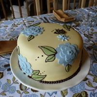 Butter Yellow And Periwinkle Flower Cake This cake was made to complement the table decor at a tea party I hosted, but I think it would be perfect for Mother's Day, also....