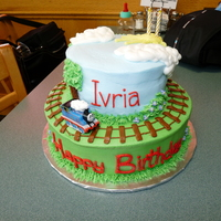 Thomas The Tank Engine Cake  Thomas the Tank Engine cake to match the theme for a little girl's birthday. This was my first stacked cake. Many thanks to all the CC...