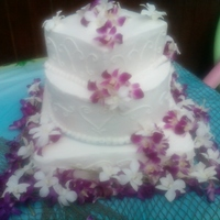 Tropical Wedding Cake Made this for outdoor Wedding. The bride had the orchids flown in from Hawii. This a pina Colada flavored cake with B/C