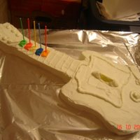 Guitar Hero Cake This was made as a birthday cake. Key Lime flavored cake and butter cream frosting. Slices of lime for details